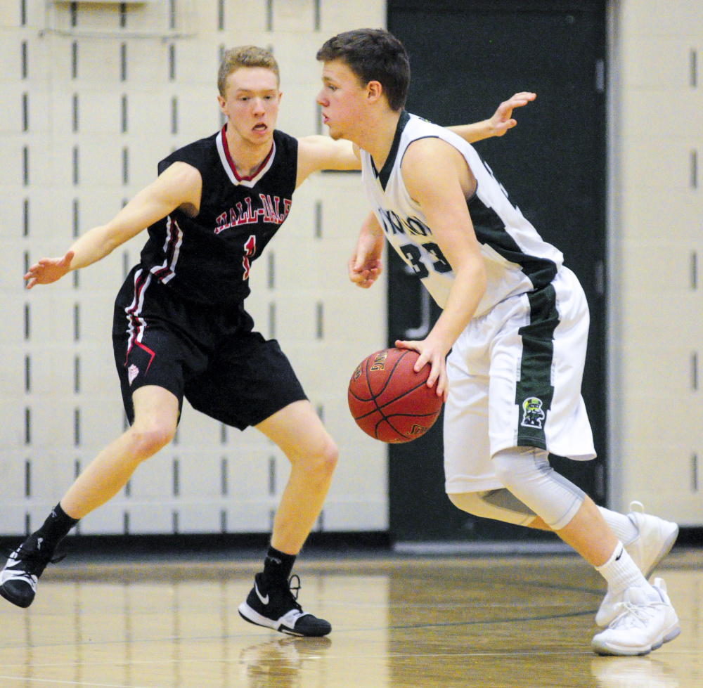 Hall-Dale's Dean Jackman, left, plays defense on Winthrop's Nate Leblanc during a game Saturday in Winthrop.