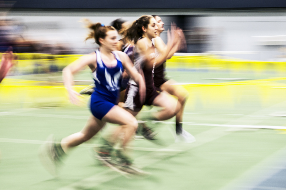 Nokomis High School's Celia Smith, center, competes in the 55 meter dash during an indoor track and field meet Friday at Colby College in Waterville.