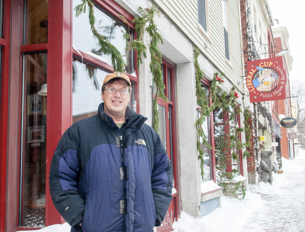 "Restaurateur Geoff Houghton sits in his first brew pub, The Liberal Cup in Hallowell, on Friday. Houghton says he's concerned the upcoming Water Street construction project will result in significant sales losses that could hamper his ""being able to keep my staff intact."""