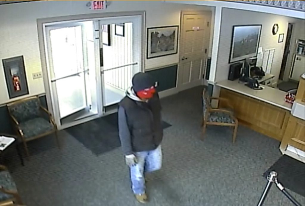 The robber enters the Skowhegan Savings Bank branch in Norridgewock on Tuesday.