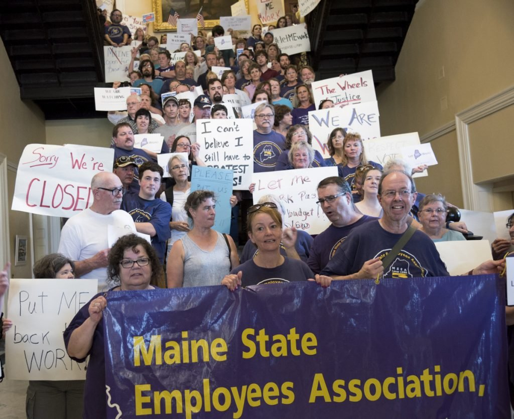 State employees pack the stairs July 3 in the State House Hall of Flags as they worked to keep pressure on lawmakers and Gov. Paul LePage to get a budget approved and end a government shutdown.