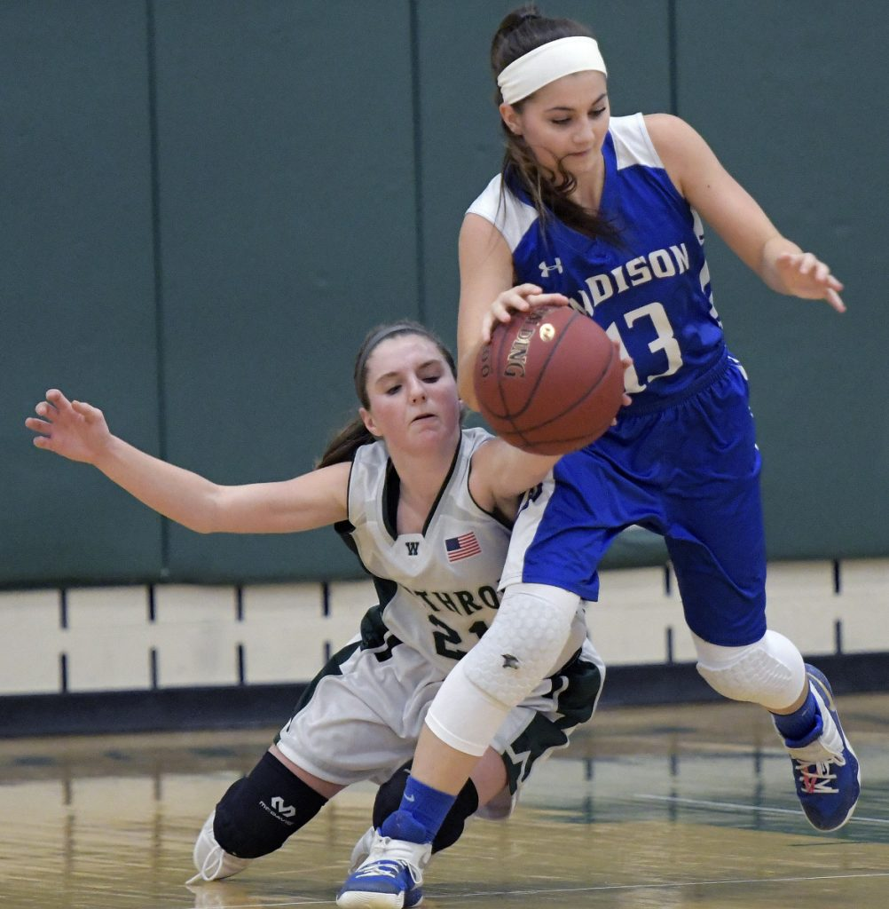 Winthrop's Katie Perkins, left, strips the ball from Madison's Emily Edgerly during a Mountain Valley Conference game Tuesday in Winthrop.