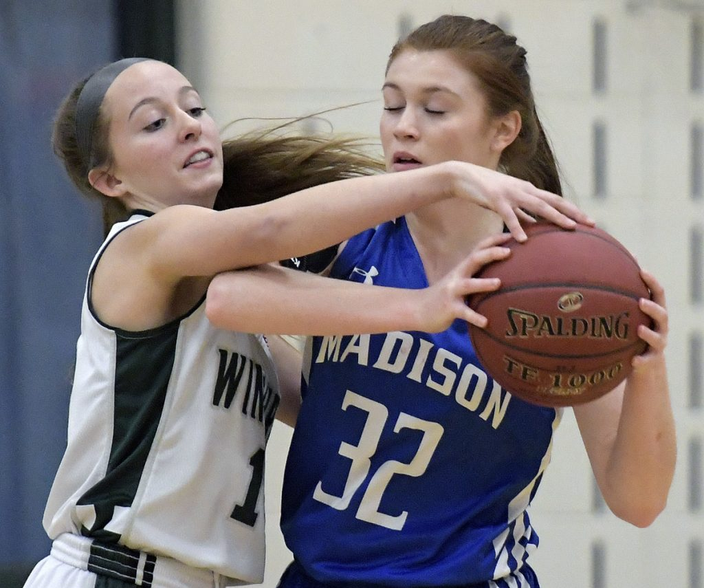 Winthrop's Madison Forgue, left, blocks Madison's Lauren Hay during a Mountain Valley Conference game Tuesday in Winthrop.