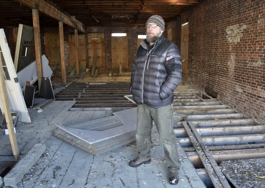 Jason Cooke, standing on Wednesday inside his Water Street property in Skowhegan, has been awarded $20,000 in tax-increment financing funds to help renovate two vacant storefronts in the building at 151 Water St.