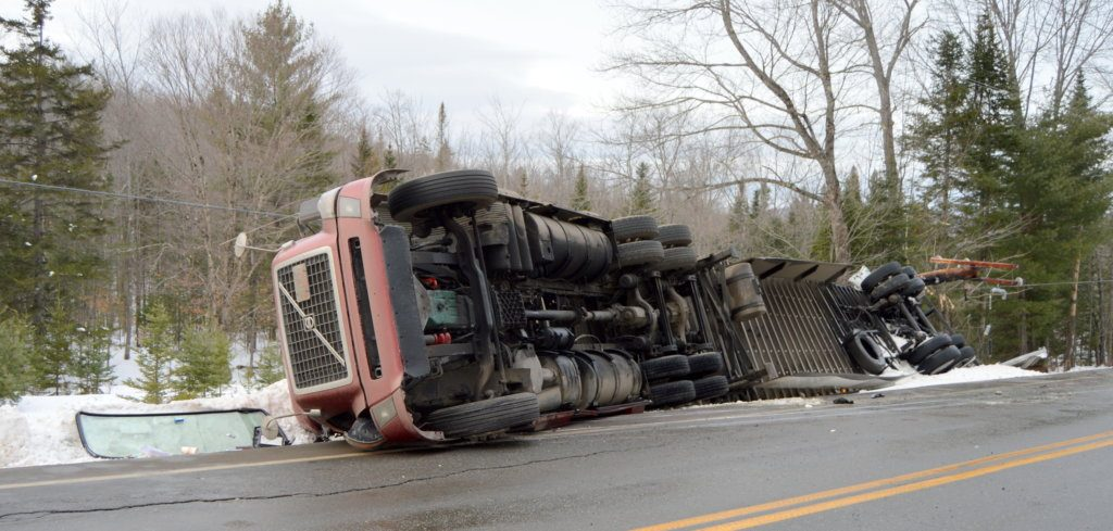 A Utah truck driver was uninjured Thursday afternoon when his tractor-trailer went off the road and rolled over on Route 27 in New Vineyard.