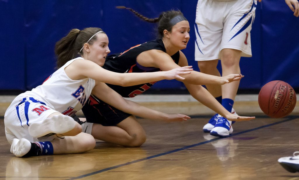 Messalonskee's Katie Seekins (left) and Gardiner's Aimee Adams battle for a loose ball during the first half of their Kennebec Valley Athletic Conference Class A game Thursday in Oakland.