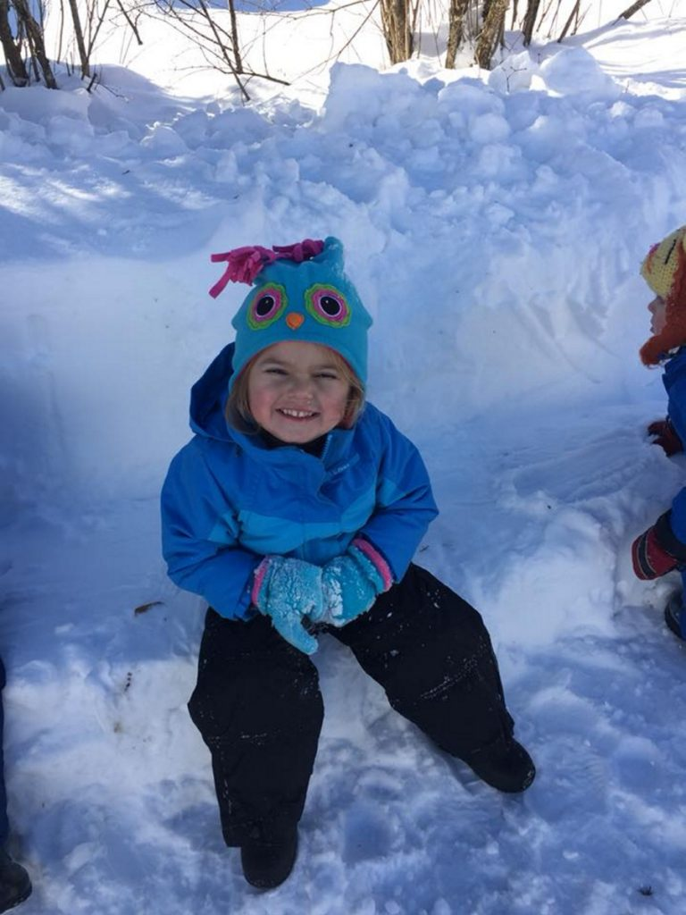 Anna Belliveau makes a face while playing outside at Conley Connections daycare in Skowhegan.