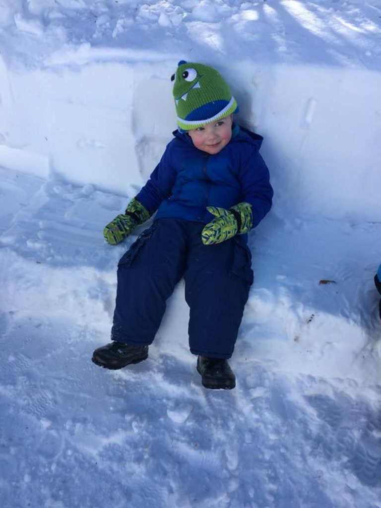 Asher Aldrich takes a break from playing outside at Conley Connections daycare in Skowhegan.