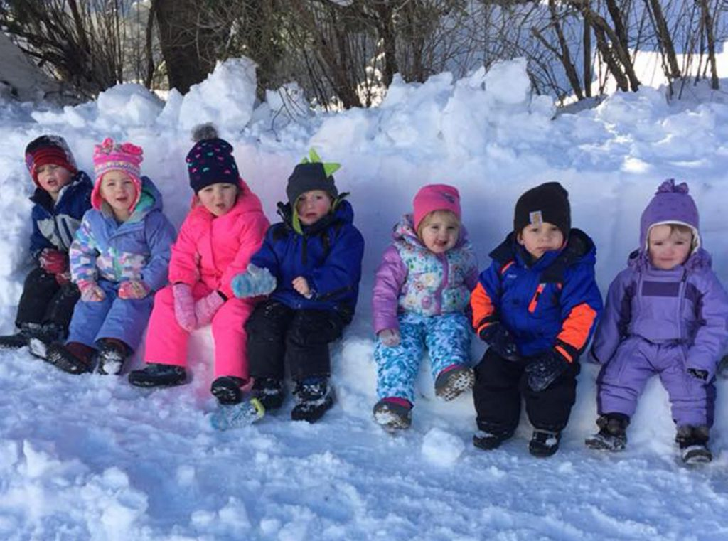 Children at Conley Connections daycare in Skowhegan sit on a snow bench. From left are Willie Tessier, Alizah Frons, Leah Haney, Zeke Jones, Emerson Thompson, Ethan Belliveau and Riley Miller.