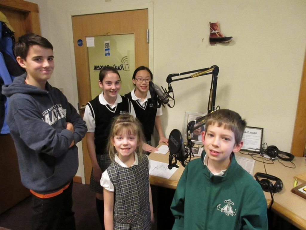 Students of St. John's Catholic School spent some time in the recording studio with Jim Bleikamp of Radio 9 WCME. In front, from left, Luke Flanagan (recent graduate), Riley Shean and Isaac Shean. In back, from left are Shannon Flanagan and Emma Tweed. The students talked about what they love about their school and their upcoming Open House scheduled for noon to 2 p.m. Sunday, Jan. 28, at the school, 15 S. Garand St. For more information, call 725-5507.