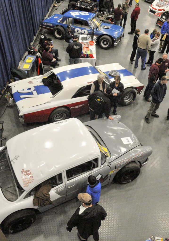 People look at cars on display at the Wicked Good Vintage Racing Association booth Saturday at the Augusta Civic Center.
