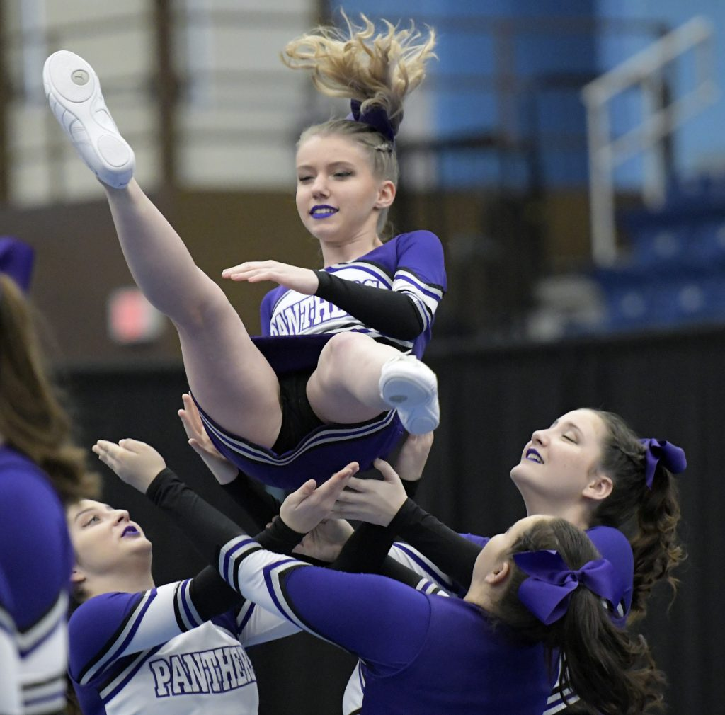 Waterville cheerleaders compete during the Kennebec Valley Athletic Conference championships Monday in Augusta.