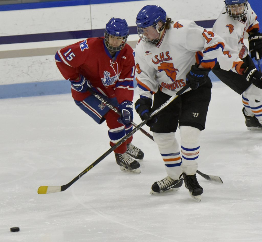 Messalonskee's Reilly Benecke, left, and Lawrence/Skowhegan/MCI's Jacob Suttie play Monday at Alfond Rink in Waterville.