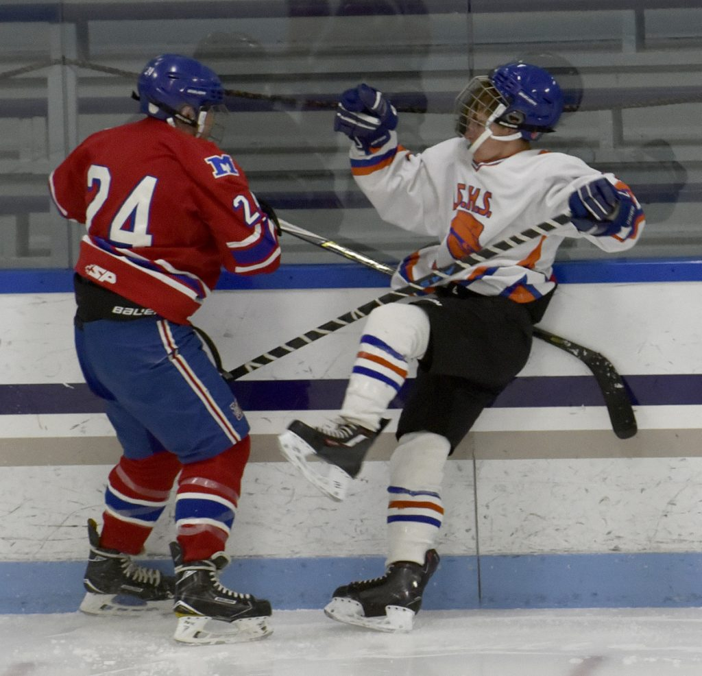 Messalonskee's Nicholas Fontaine slams a Lawrence/Skowhegan/MCI player during a game Monday at Alfond Rink in Waterville.