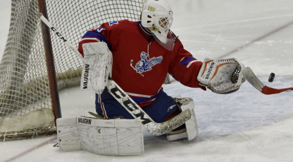 Messalonskee goalie Eli Michaud makes a save against Lawrence/Skowhegan/MCI on Monday at Alfond Rink in Waterville.
