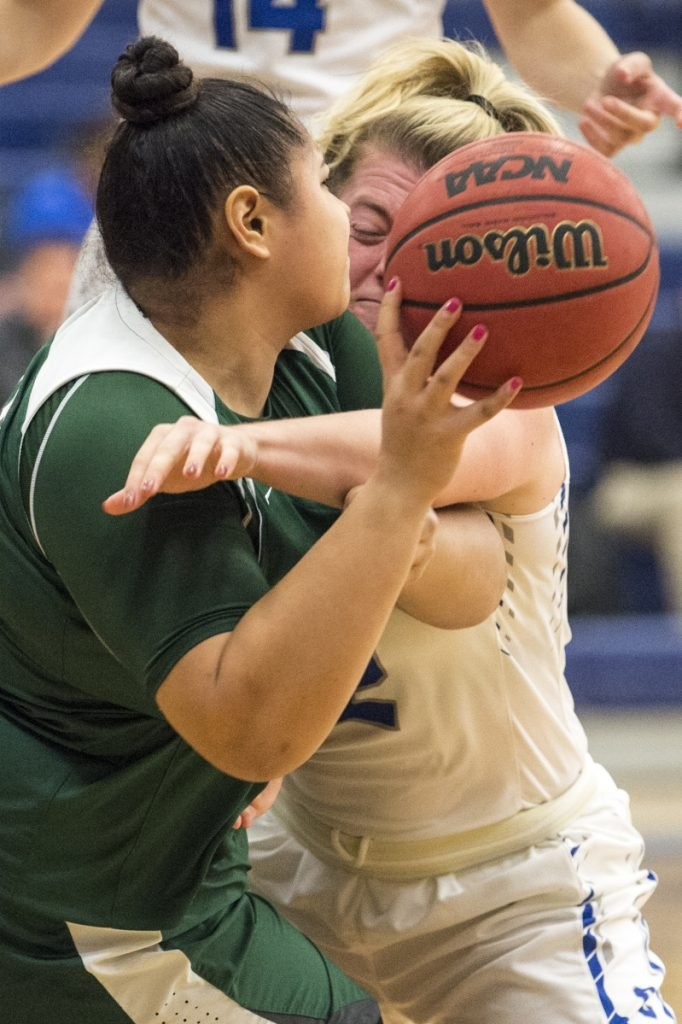 Pine Manor College's Aleah Lauti, left, battles for the loose ball with Colby College's Sarah Hancock on Tuesday at Colby College in Waterville.
