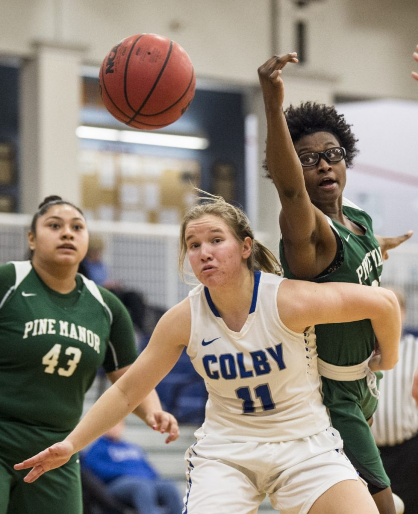 Colby College's Paige Russell (11) boxes out Pine Manor College's Nakazja Holley for the rebound Tuesday at Colby College in Waterville.