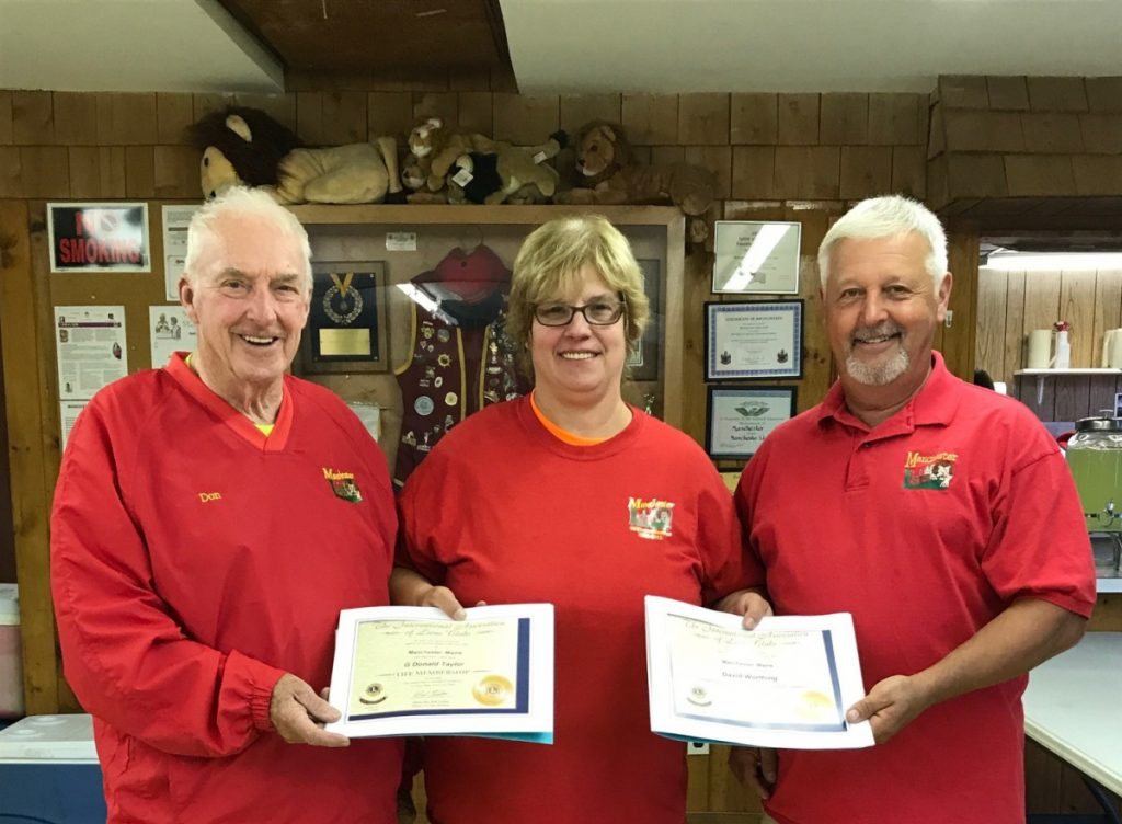 Lion Don Taylor, left, Past President Deb Maddox and Lion David Worthing.
