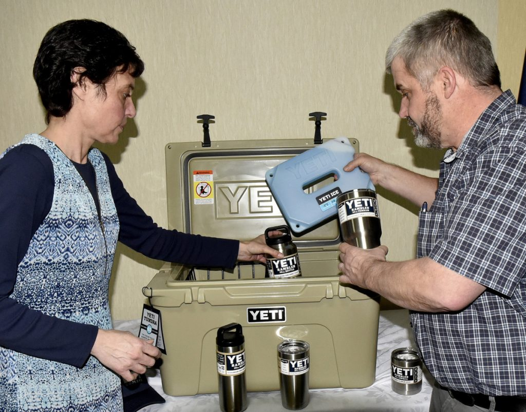 Angela Derosby and Bob Marin fill a Yeti cooler with other products that make up a door prize for entrants of the 20th annual Gene and Lucille Letourneau Ice Fishing Derby, scheduled for Feb. 18.