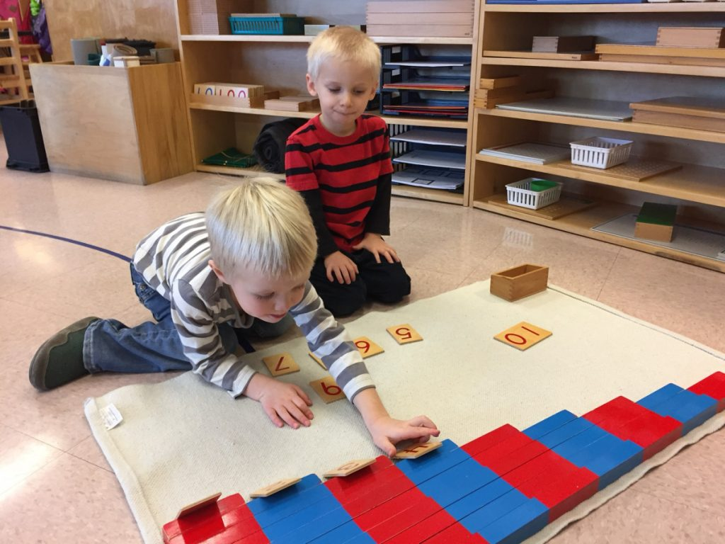Kennebec Montessori School students James Browne, left, works on a math skill as Robert Krickus waits for his turn.