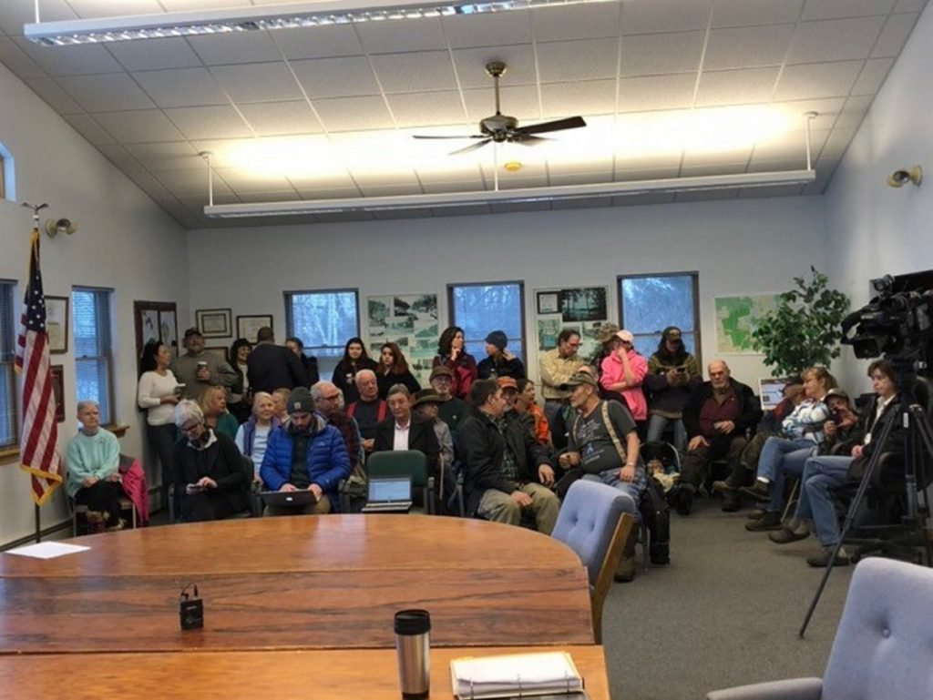 A standing-room-only crowd waits Tuesday morning at the Jackman Town Office as selectmen meet in executive session to discuss the employment of Town Manager Tom Kawczynski following widespread uproar over his white separatist views.