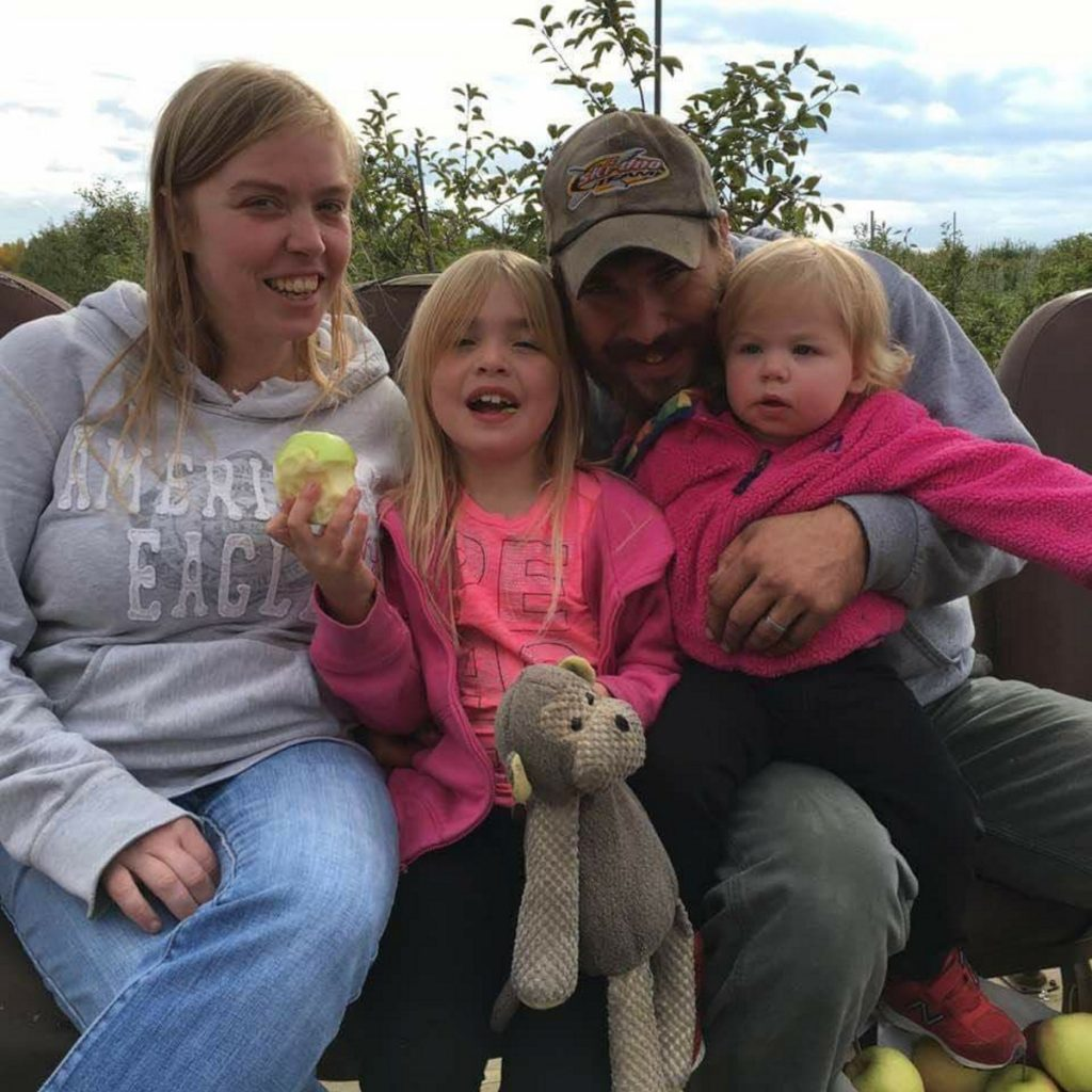 Desiree Strout and Harry Weeks with their daughters, ages 8 and 2. Strout, nine months pregnant, was on her way to Redington-Fairview Hospital in Skowhegan to have labor induced when the vehicle she was driving hit black ice and she lost control of it. She died in the ambulance taking her to the hospital. Weeks suffered a punctured lung and a lacerated liver.