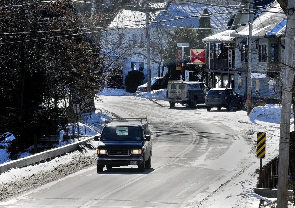 A van crosses a bridge over Mill Stream Jan. 30, 2014, as it heads north out of Belgrade Lakes village on Route 27. A two-year road reconstruction project is expected to begin there later this year.