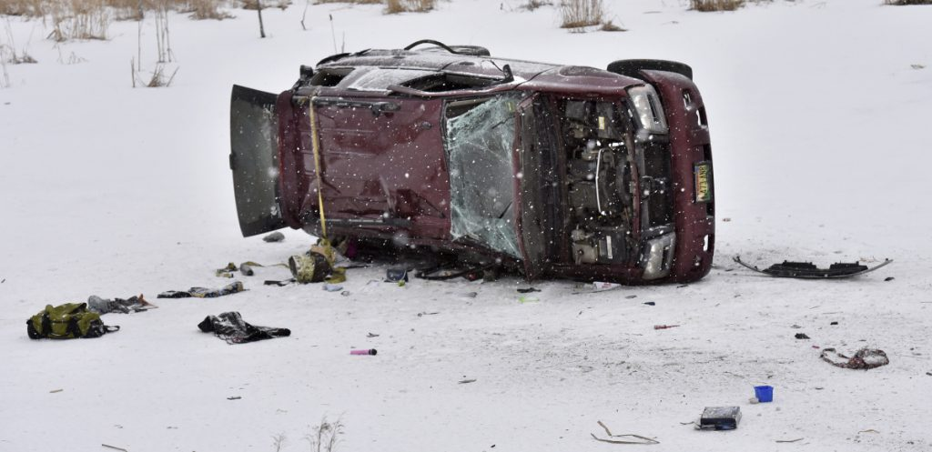 An overturned truck lies on the ice of a small pond early Monday along U.S. Route 2 in Skowhegan.