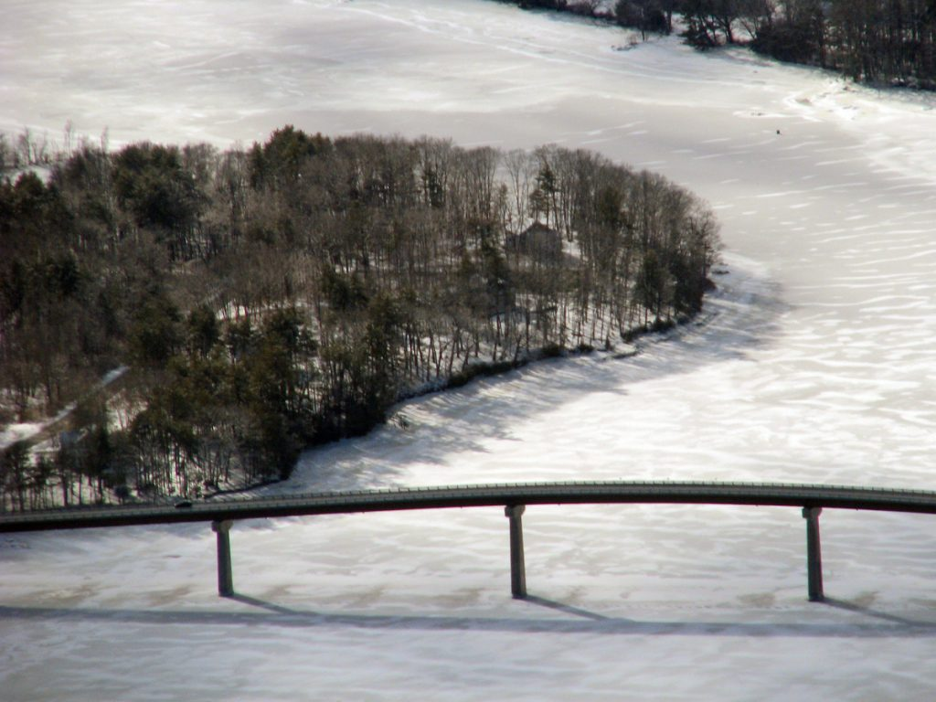 Solid ice around the Kennebec Maine Bridge is seen Wednesday with the Dresden shore at left and Swan Island at top.