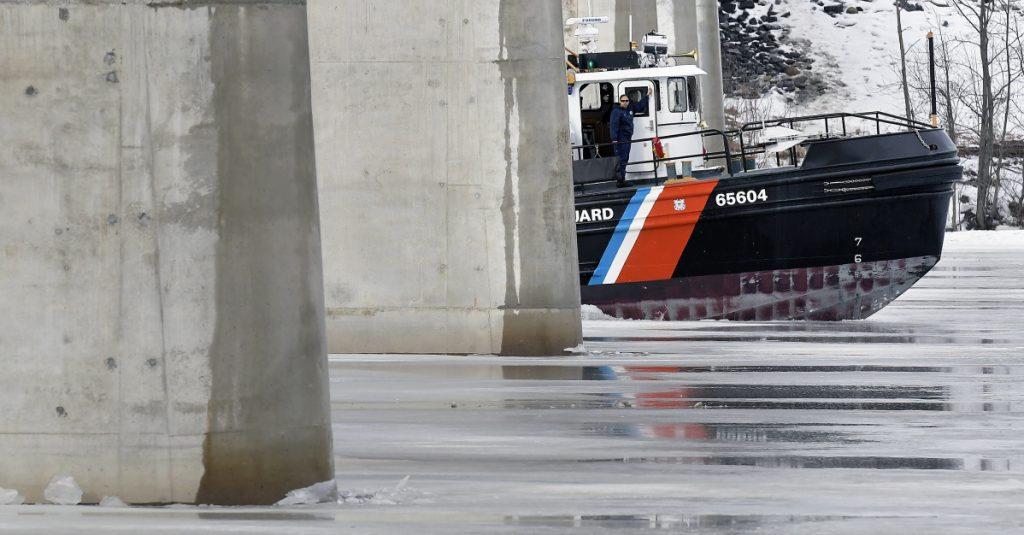 USCG ice breaker on Sunday busts beneath the bridge spanning the Kennebec River between Richmond and Dresden.