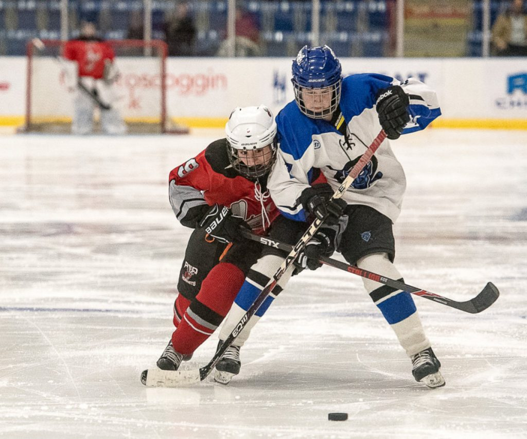Lewiston/Oak Hill/Monmouth forward Anna Dodge looks to fend off Edward Little/Poland/Leavitt's Taylor Caillier during a Dec. 20, 2017 game at the Androscoggin Bank Colisee in Lewiston.