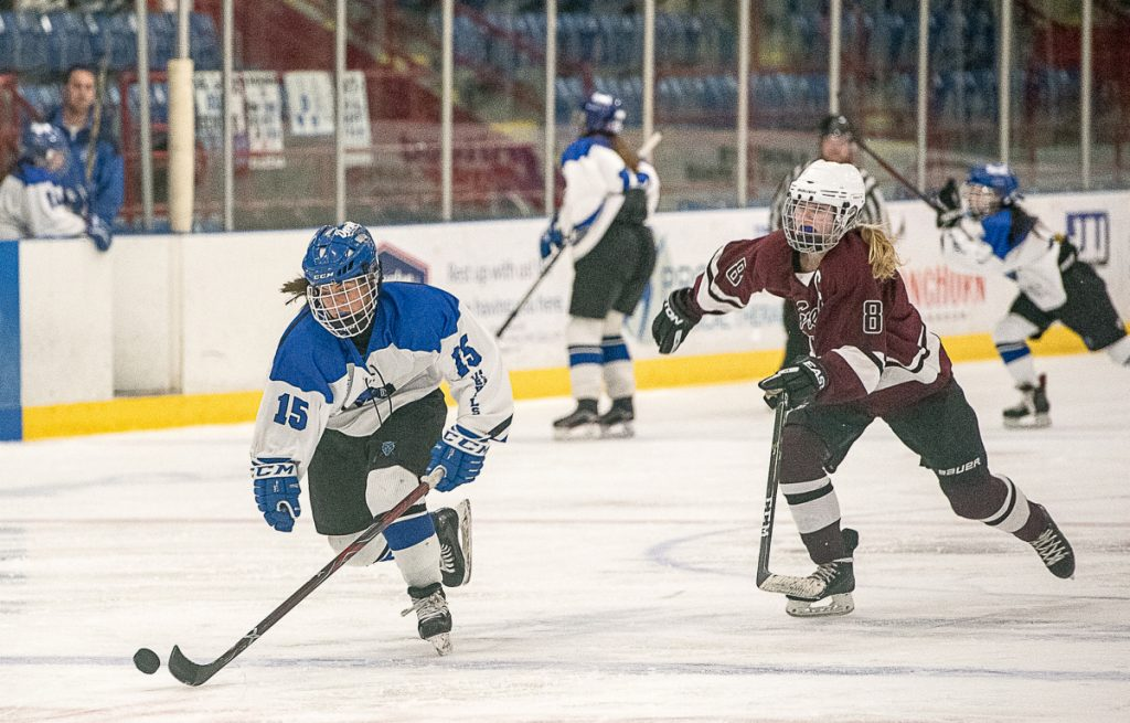 Lewiston/Monmouth/Oak Hill's Sara Robert is chased by Greely/Gray-New Gloucester's Molly Horton during a game at the Androscoggin Bank Colisee in Lewiston last Friday night.
