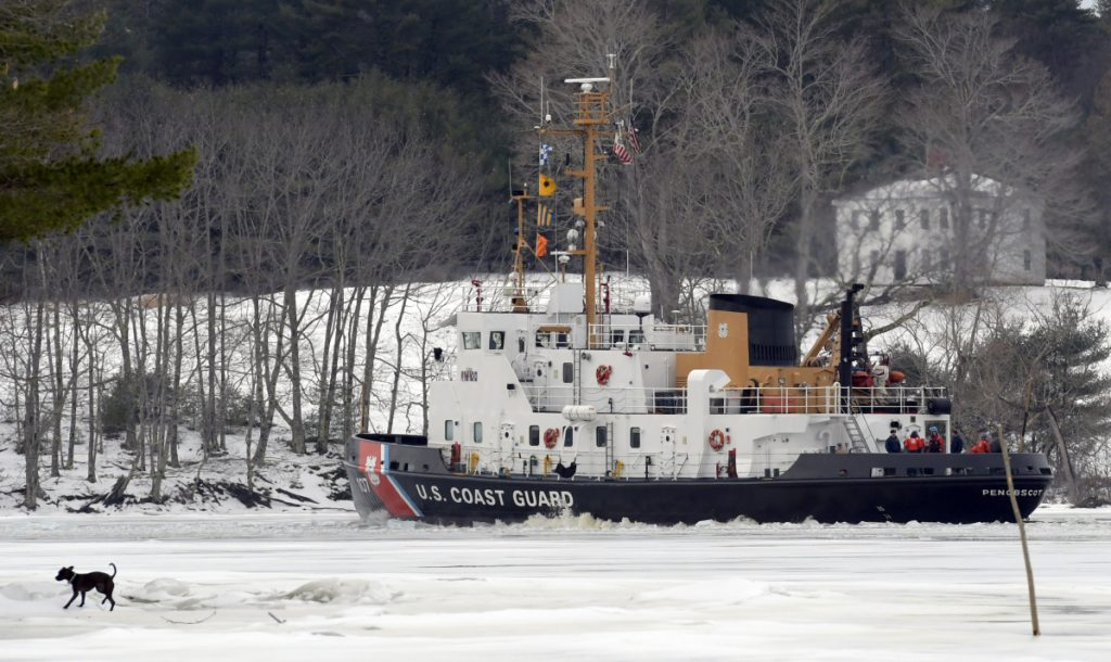 The USCGC Penobscot Bay on Sunday breaks a path through the Kennebec River between Richmond and Dresden.