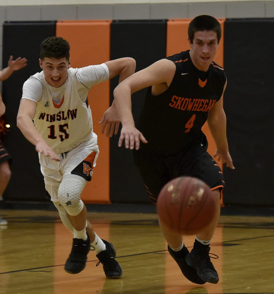 Skowhegan's Marcus Christopher, right, and Winslow's Jack Morneault scramble for a loose ball during a Kennebec Valley Athletic Conference game Tuesday in Winslow.