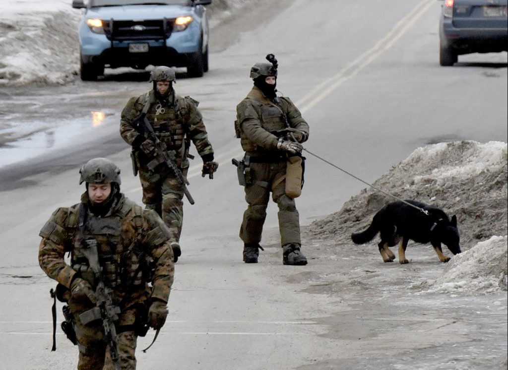 Heavily armed state police troopers and a dog walk along West Street in Fairfield on Tuesday toward a residence near the Montcalm Street intersection, where police were engaged in a standoff with Kenneth J. Ruggiero. Ruggiero was arrested without incident and charged with domestic violence assault, domestic violence terrorizing and refusing to submit to arrest.