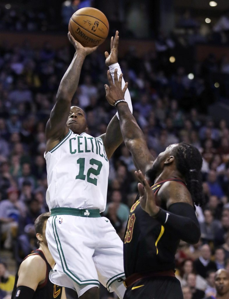 Boston's Terry Rozier  shoots over Cleveland's Jae Crowder in the fourth quarter Wednesday night in Boston. Rozier scored 20 points in Boston's 102-88m win.