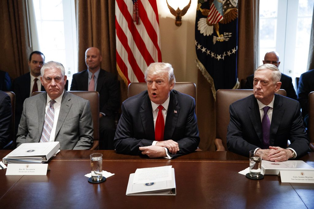 Secretary of State Rex Tillerson, left, and Secretary of Defense Jim Mattis listen as President  Trump speaks during a Cabinet meeting Wednesday.