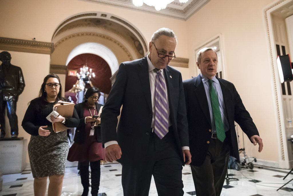 Senate Minority Leader Chuck Schumer, D-N.Y., left, walks with Sen. Dick Durbin, D-Ill., the minority whip, as lawmakers continue negotiating on a deal that would include a fix for the Deferred Action for Childhood Arrivals (DACA) program, at the Capitol in Washington, Thursday.