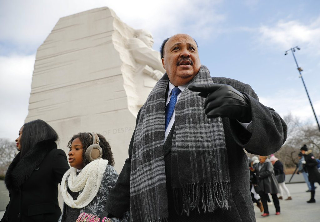 Martin Luther King III, right, with his wife Arndrea Waters, left, and their daughter Yolanda, 9, center, during their visit to the Martin Luther King Jr., Memorial on the National Mall in Washington, Monday.