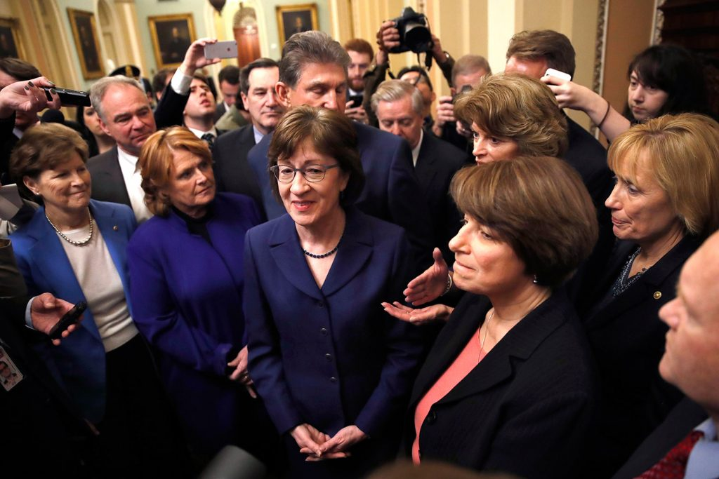 Following a procedural vote aimed at reopening the government, Sen. Susan Collins, R-Maine, center, was praised by her fellow lawmakers for leading the bipartisan effort at the Capitol in Washington on Monday. From left are, Sen. Jeanne Shaheen, D-N.H., Sen. Heidi Heitkamp, D-N.D., Collins, behind Collins is Sen. Joe Manchin, D-W.Va., Sen. Lisa Murkowski, R-Alaska, Sen. Amy Klobuchar, D-Minn., and Sen. Maggie Hassan, D-N.H.