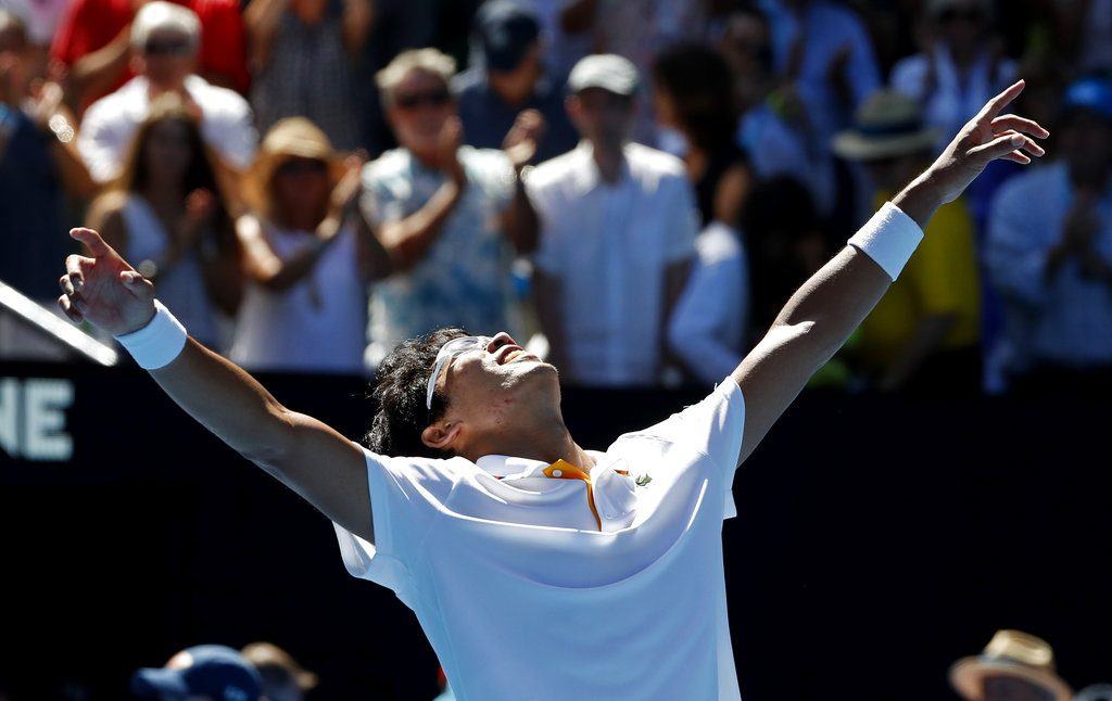 South Korea's Chung Hyeon celebrates after defeating American Tennys Sandgren in their quarterfinal at the Australian Open in Melbourne Wednesday.