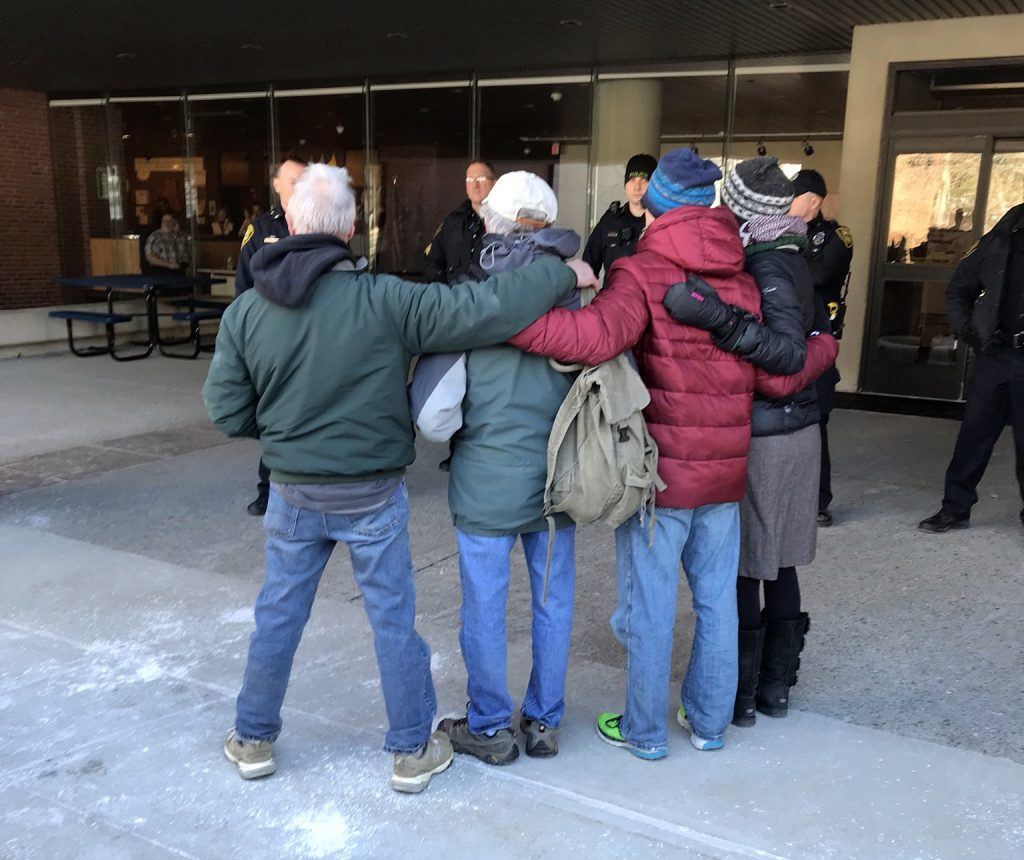 Four protesters willfully getting arrested at Central Maine Power protests on Monday.