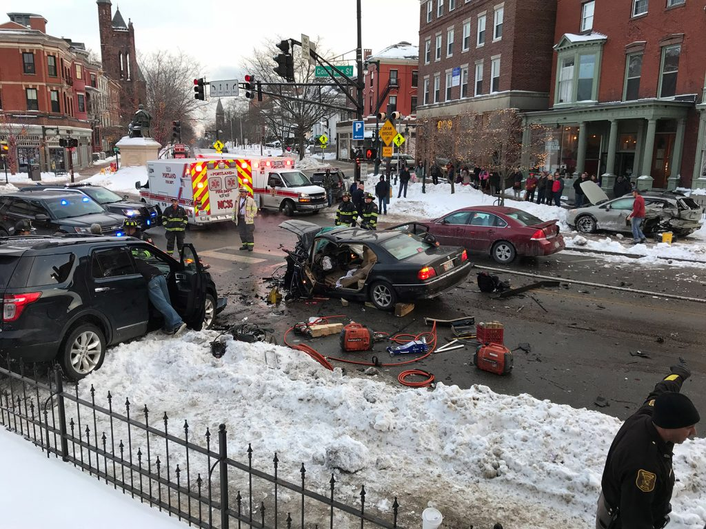 Multiple people were being treated for injuries that were not considered life-threatening after a vehicle crashed into numerous others on Congress Street in Portland on Wednesday.