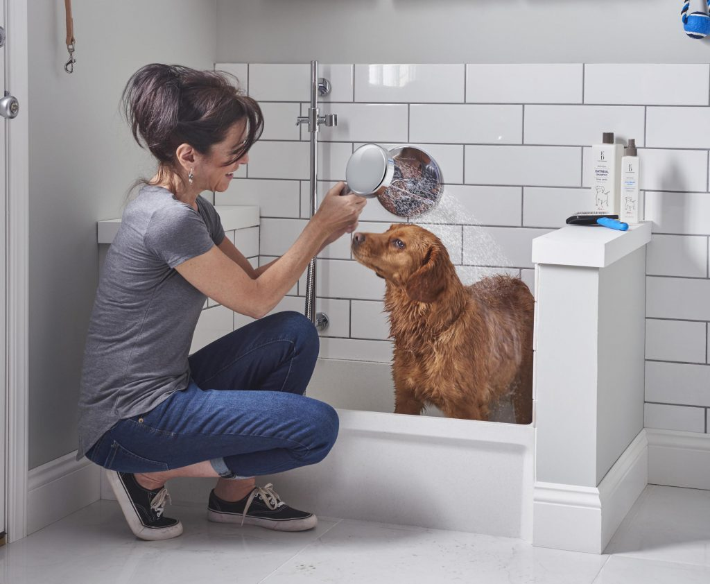 The Fiat Molded Stone mop service basin and multi-function hand shower is handy for dog-washing in the mud room.