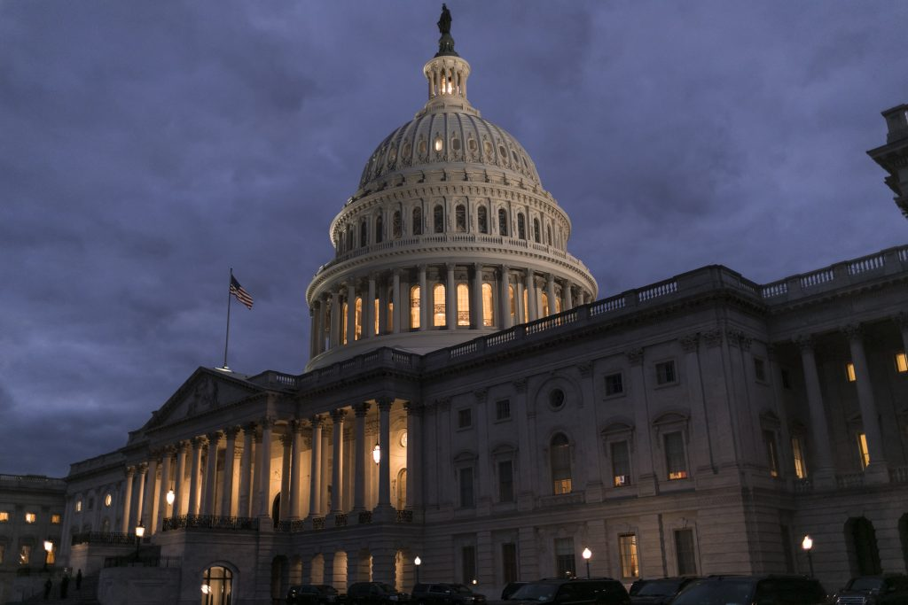 Lights illuminate the U.S. Capitol on second day of the federal shutdown as lawmakers negotiate behind closed doors in Washington, Sunday, Jan. 21, 2018. (AP Photo/J. Scott Applewhite)