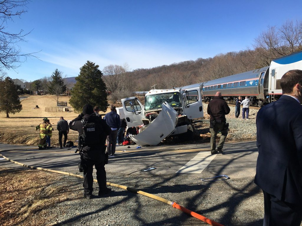 NTSB investigating report of malfunction after train hits garbage truck, 1 dead