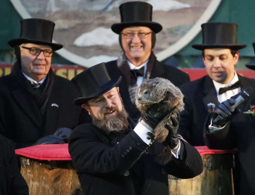 Groundhog Club co-handler Al Dereume holds Punxsutawney Phil, the weather prognosticating groundhog, during the 132nd celebration of Groundhog Day on Gobbler's Knob in Punxsutawney, Pa. on Friday.