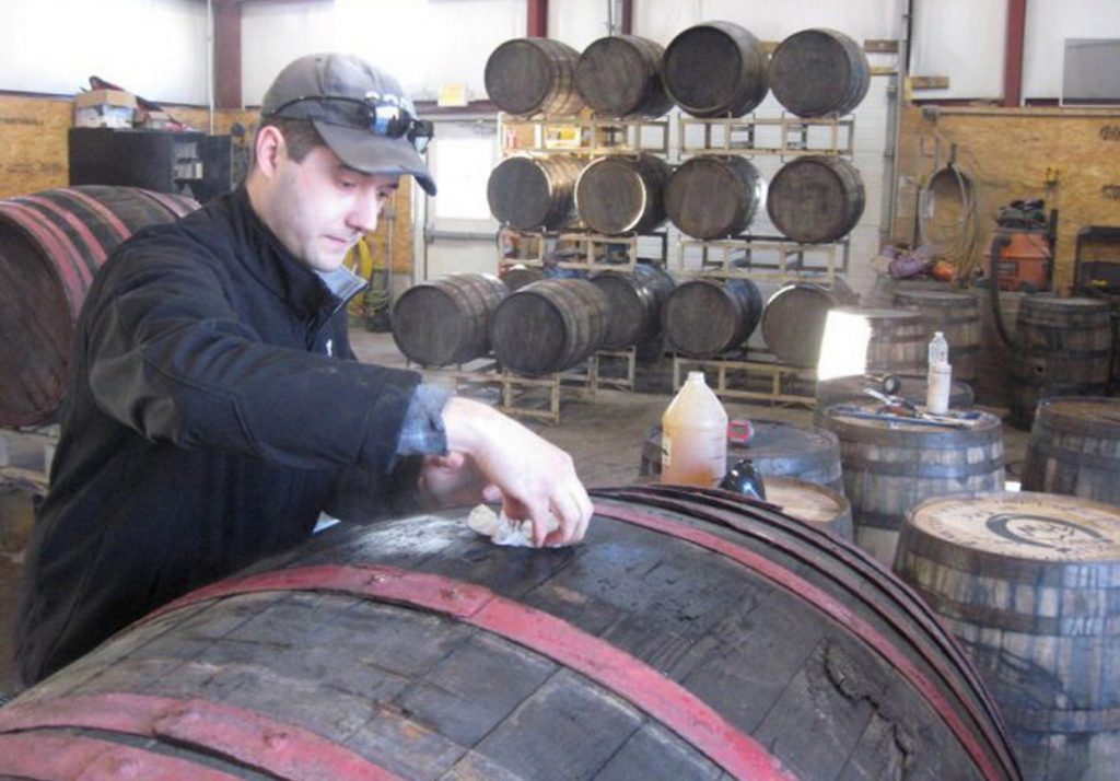 "Matt Albrecht, owner and founder of River Drive Cooperage-Millwork in Buxton, prepares a barrel he imported from Hungary for shipment to Michigan. ""Our goal is to push the limits on beer barrel aging,"" he said."