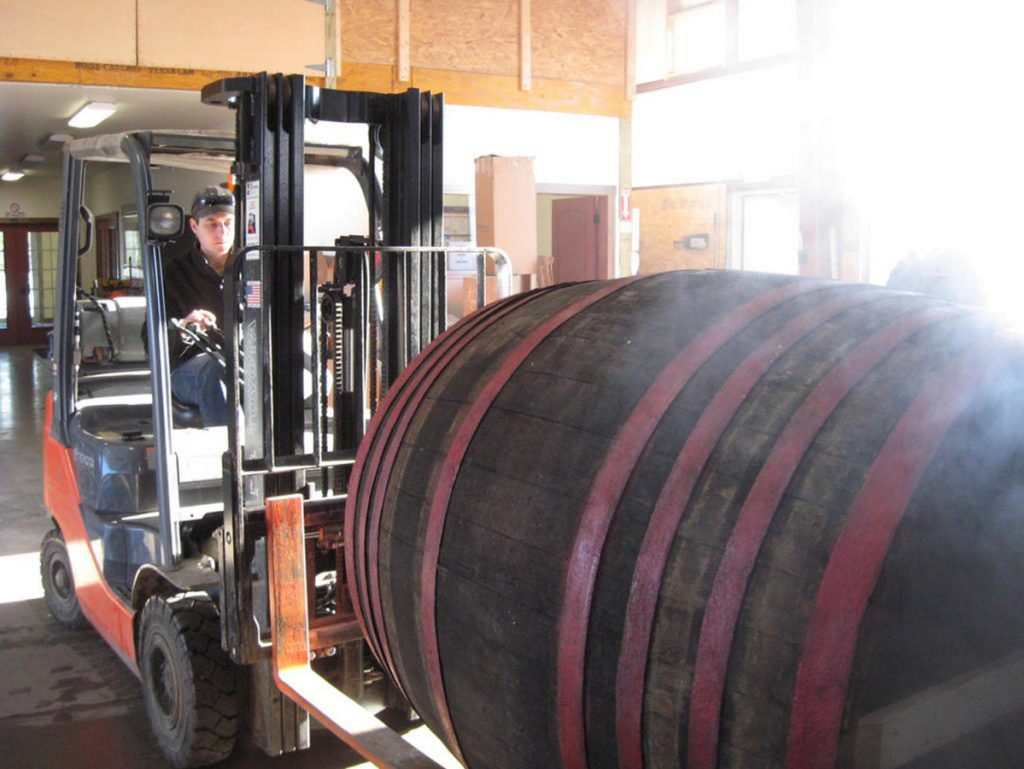 Matt Albrecht moves a 1,000-liter beer barrel to be shipped to Michigan. He plans an expansion that will allow his business to double the number of barrels they currently process.