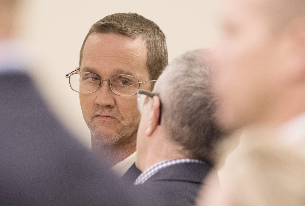 Philip Scott Fournier listens to his attorney Jeffrey Silverstein in a court appearance in 2016.
